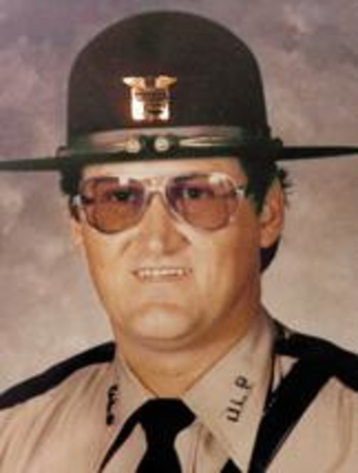 Photo - MUG: Water Enforcement Safety Officer Mark Harris  Harris joined the Oklahoma Lake Patrol in 1982.  Officer Harris was en route to investigate a reported drowning at Lake Thunderbird when he stopped a vehicle on I-35 near Indian Hills Road in Cleveland County for speeding. As he wrote the citation, a car traveling on the interstate ran off the road, struck Officer Harris, then smashed into the second car. Officer Harris was thrown into the roadway and struck by a third vehicle. The driver of the vehicle that ran off the road was later charged with manslaughter. The driver of the third vehicle that struck Officer Harris left the scene, and was never found.