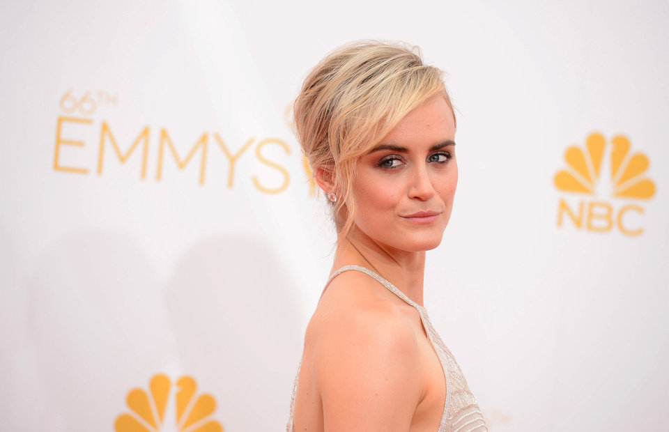 Photo - Taylor Schilling arrives at the 66th Annual Primetime Emmy Awards at the Nokia Theatre L.A. Live on Monday, Aug. 25, 2014, in Los Angeles. (Photo by Jordan Strauss/Invision/AP)