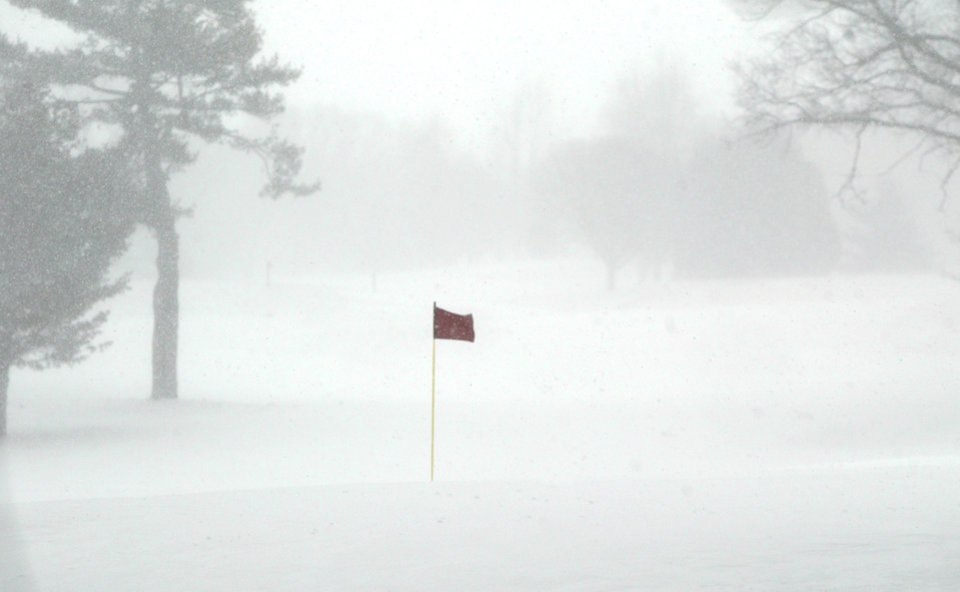 Wind and snow blow across the fairways at the Muskegon Country Club on Tuesday, March 19, 2013, in Muskegon, Mich.  A late winter storm is dumping snow on Michigan's Upper Peninsula, with up to 2 feet forecast in places.   Heavy lake-effect snow is expected along Lake Superior. Occasional white-out conditions are forecast into Wednesday. In parts of the northern Lower Peninsula, 6 to 9 inches of snow is forecast by Thursday morning. Some areas could see more than a foot. (AP Photo/The Muskegon Chronicle, ) ALL LOCAL TV OUT; LOCAL TV INTERNET OUT