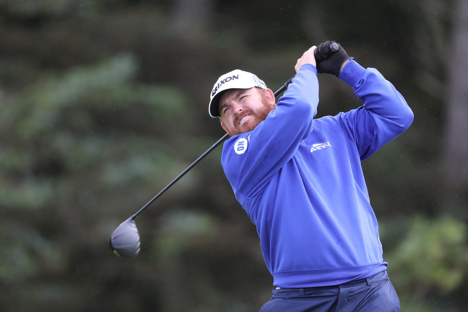 Photo -  J.B. Holmes shot a 5-under 66 Thursday to lead a major for the first time in 11 years. [AP Photo/Str]