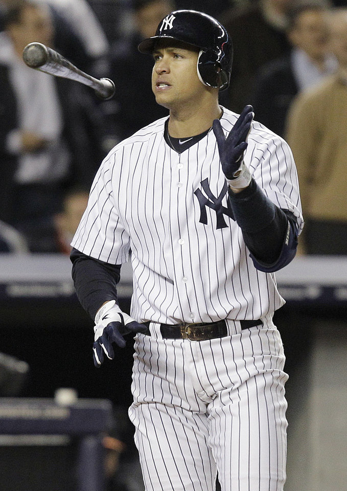 Photo -   New York Yankees' Alex Rodriguez tosses his bat after striking out to end the sixth inning of Game 4 of the American League division baseball series against the Baltimore Orioles, Thursday, Oct. 11, 2012, in New York. (AP Photo/Kathy Willens)