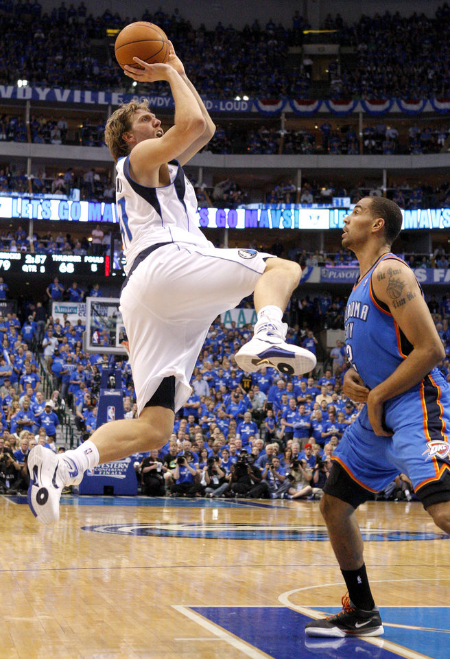 Dirk Nowitzki (41) of Dallas shoots the ball beside Oklahoma City's Thabo Sefolosha (2) during game 1 of the Western Conference Finals in the NBA basketball playoffs between the Dallas Mavericks and the Oklahoma City Thunder at American Airlines Center in Dallas, Tuesday, May 17, 2011. Photo by Bryan Terry, The Oklahoman