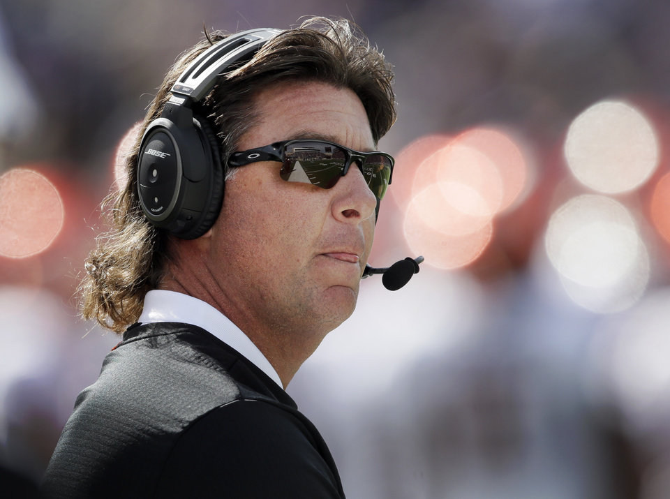 Photo -  With a 4-3 record and five conference games left, coach Mike Gundy and Oklahoma State face an uphill battle to reach bowl eligibility. [AP PHOTO]