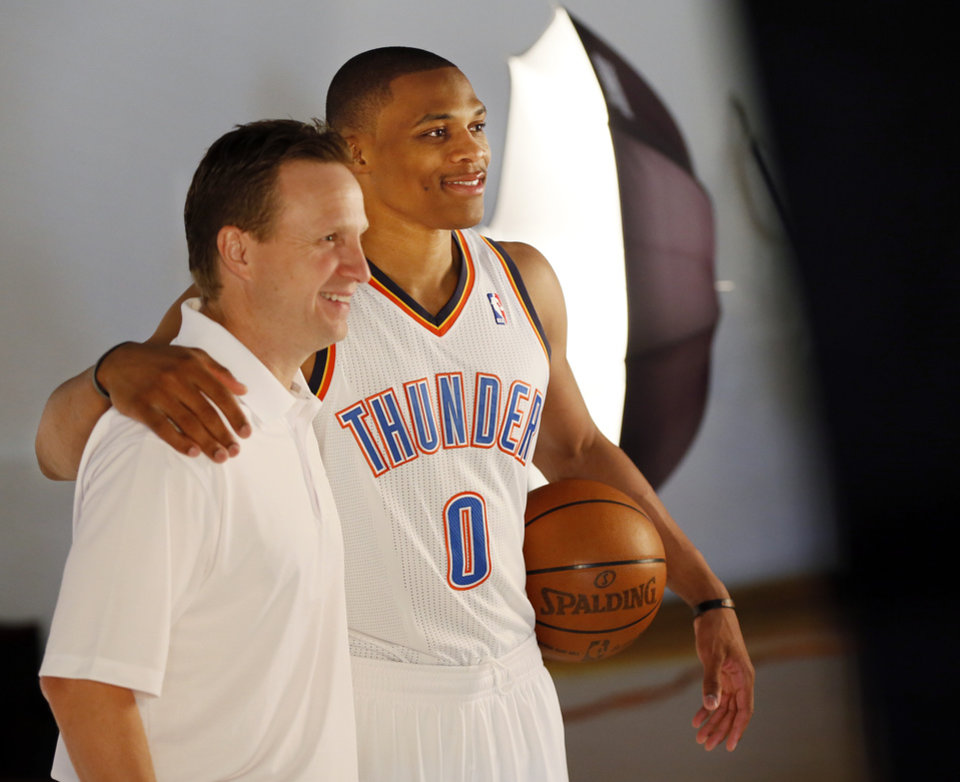 Photo - Coach Scott Brooks, left, and Russell Westbrook pose for a photo during media day for the Oklahoma City Thunder NBA basketball team at the Thunder Events Center in Oklahoma City, Monday, Oct. 1, 2012.  Photo by Nate Billings, The Oklahoman