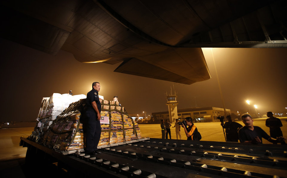 Photo - FILE - In this Wednesday, Nov. 13, 2013 file photo, Malaysian air force personnel load relief supplies donated by the government for victims of Typhoon Haiyan in the Philippines, at the Air Force base in Subang, Malaysia. Foreign governments and agencies have announced a major relief effort to help victims of the Philippine typhoon. (AP Photo/Vincent Thian)