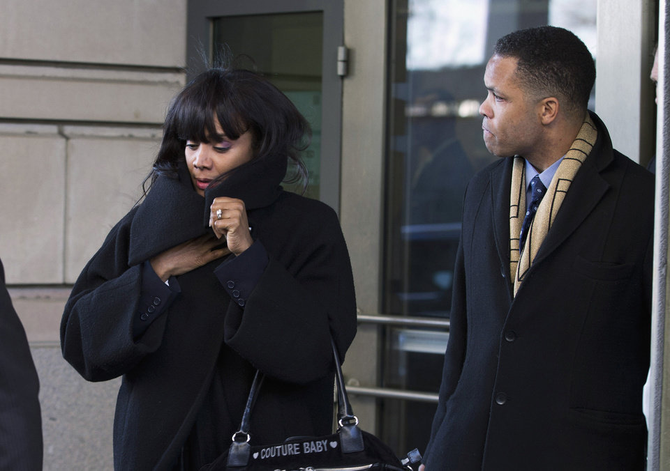 Photo - FILE - In this Feb. 20, 2013 file photo, former Illinois Rep. Jesse Jackson Jr. and his wife Sandi leave federal court in Washington. The sweep of Jesse Jackson Jr.'s life, from golden boy who could be president to broken politician, will be laid out for a federal judge in Washington, D.C., Wednesday, Aug. 14, 2013, as she sentences him and his wife for misusing $750,000 in campaign money on a gold-plated Rolex watch, mink capes, mounted elk heads and other personal items. (AP Photo/Evan Vucci, File)