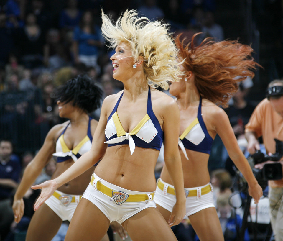 Photo - The Thunder Girls dance team performs during a break in the action at the NBA basketball game between the Los Angeles Lakers and the Oklahoma City Thunder at the Ford Center in Oklahoma City, Friday, March 26, 2010. Photo by Nate Billings, The Oklahoman