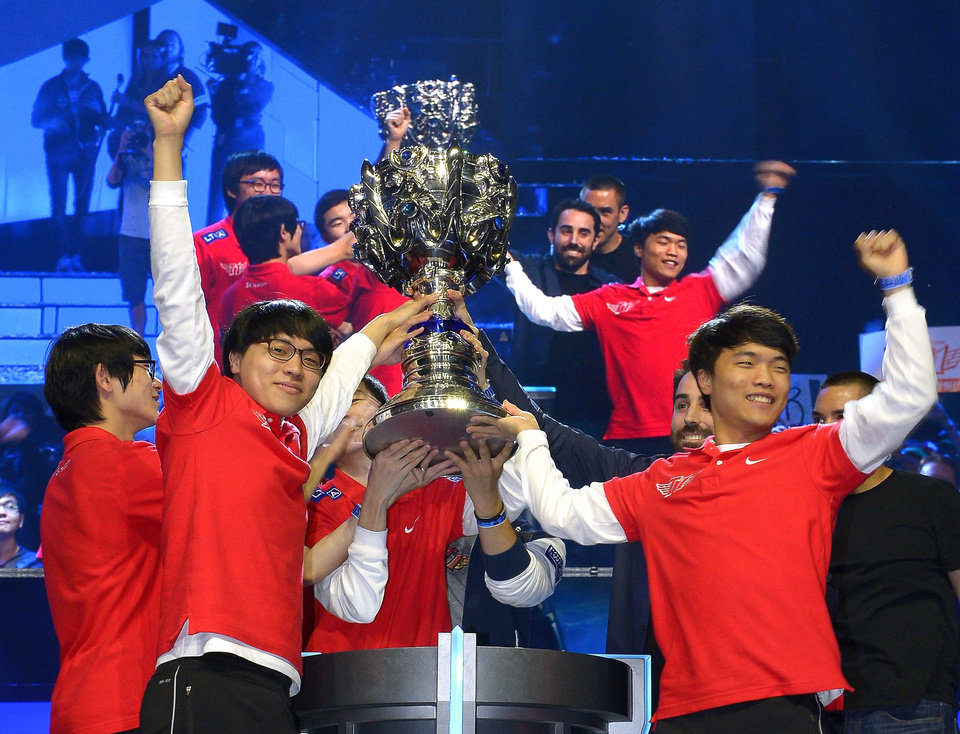Photo - FILE - In this Oct. 4, 2013, file photo, members of South Korea's SK Telecom T1 team celebrate with their trophy after defeating China's Royal Club at the League of Legends Season 3 World Championship Final in Los Angeles. Robert Morris University Illinois, a small private university in Chicago, is offering hefty scholarships for players of League of Legends, which has become one of the most popular games for organized team competitions. The university said it recognizes the growing legitimacy of what are known as