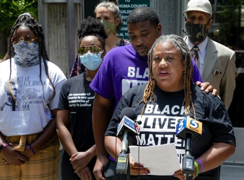 Photo -  Black Lives Matter OKC Executive Director Rev. T. Sheri Dickerson speaks during a press conference outside the Oklahoma County courthouse on Monday in Oklahoma City in response to recent charges filed by Oklahoma County District Attorney David Prater. [Chris Landsberger/The Oklahoman]