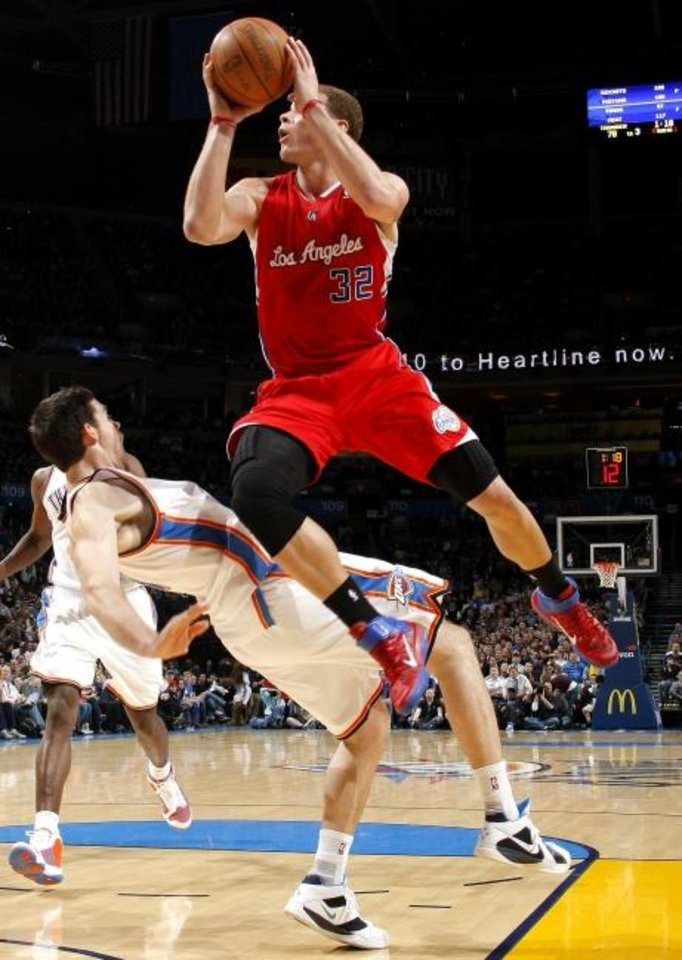 Photo -  Nick Collison became known as Mr. Thunder for many reasons, but a big one was the way he sacrificed his well being and regularly took charges as he did during the 2010-11 season against Los Angeles' Blake Griffin. [BRYAN TERRY, THE OKLAHOMAN]