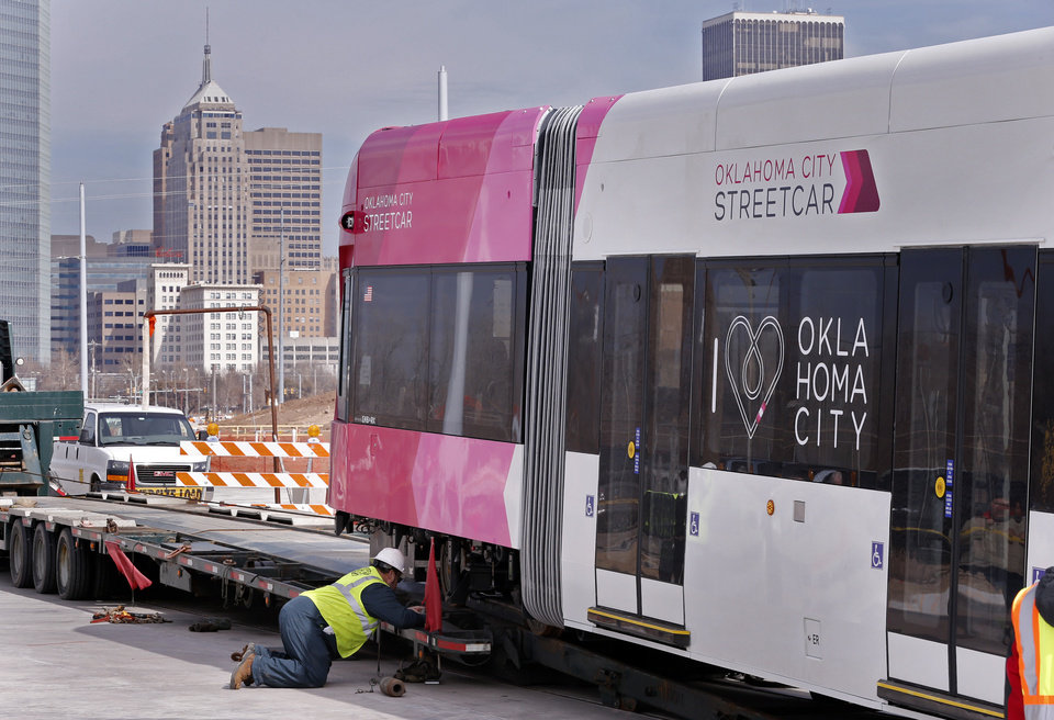 Photo - Workers carefully eased the streetcar onto the tracks. [Photo by Steve Sisney, The Oklahoman]