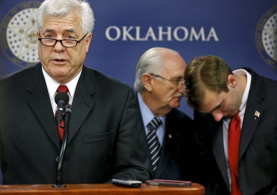 Photo -  Former state Rep. Mike Reynolds speaks during a news conference Tuesday about a settlement between the University of Oklahoma and Leone Meyer regarding the ownership of the painting