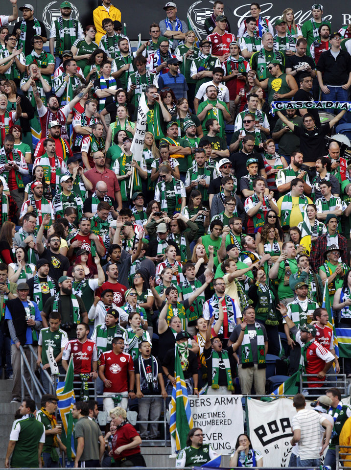 Photo -   Portland Timbers supporters cheer in the first half of an MLS soccer match against the Seattle Sounders, Sunday, Oct. 7, 2012, in Seattle. The Sounders defeated the Timbers 3-0. (AP Photo/Ted S. Warren)