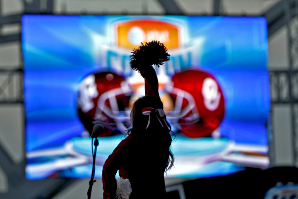 Photo - A member of the OU cheer squad performs during the pep rally during the college football Cotton Bowl game between the University of Oklahoma Sooners (OU) and Texas A&M University Aggies (TXAM) at Cowboy's Stadium on Friday Jan. 4, 2013, in Arlington, Tx. Photo by Chris Landsberger, The Oklahoman