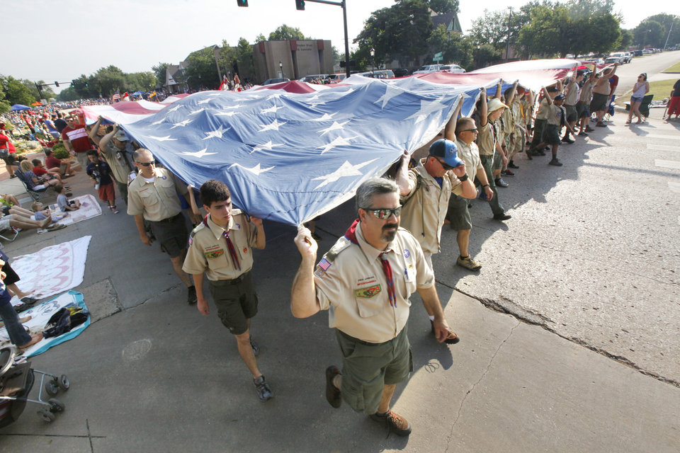 Boy Scouts and Cub Scouts carry an enormous flag in the annual LibertyFest Fourth of July Parade in downtown Edmond, OK, Thursday, July 4, 2013,  Photo by Paul Hellstern, The Oklahoman