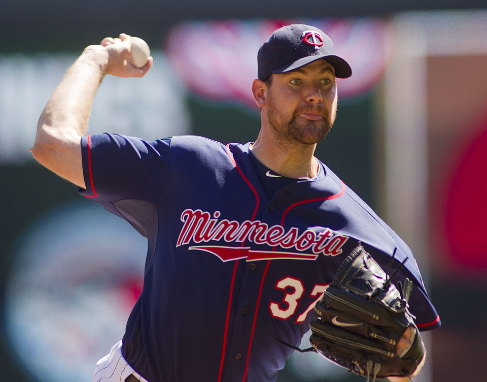 Photo - Minnesota Twins starting pitcher Mike Pelfrey (37) throws against the Oakland Athletics in the first inning of a baseball game on Thursday, April 10, 2014 in Minneapolis.(AP Photo/Andy Clayton-King)