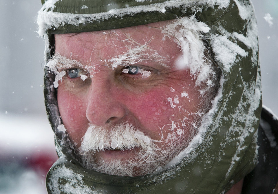 Ice clings to Ken Anderson\'s eyebrows and mustache as he uses a snowblower during a blizzard, Saturday, Feb. 9, 2013, in Portland, Maine. The storm dumped more than 30 inches of snow as of Saturday afternoon, breaking the record for the biggest storm on record. (AP Photo/Robert F. Bukaty) ORG XMIT: MERB103