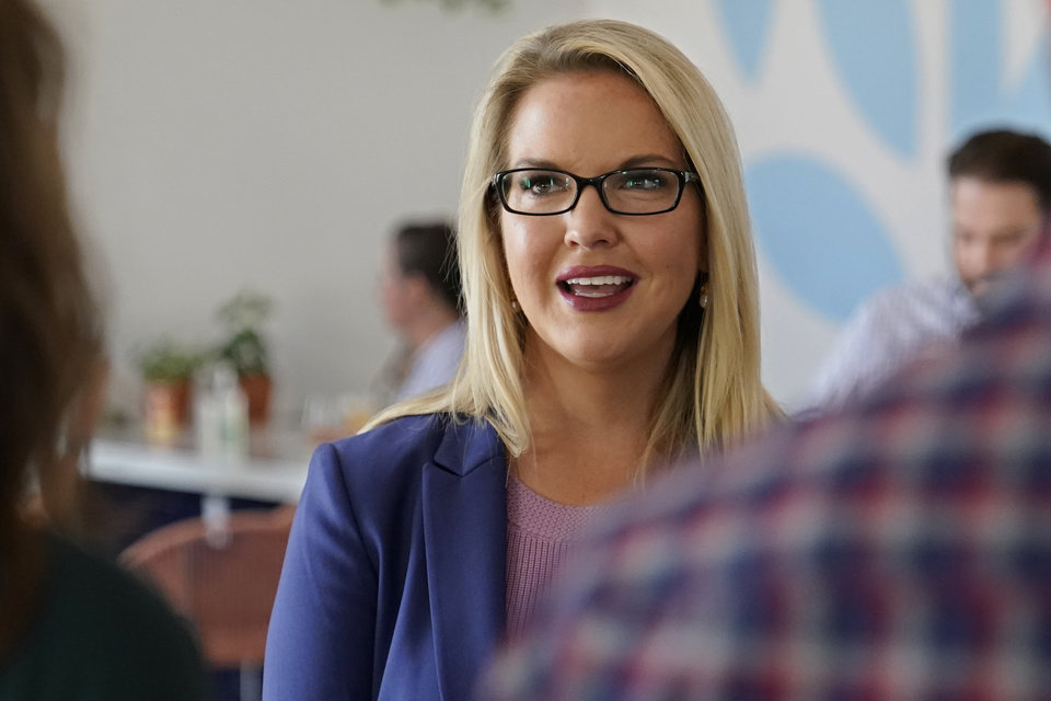 Photo - U.S. Senate candidate Abby Broyles speaks with people at a fundraiser Friday, Sept. 25, 2020, in Oklahoma City. (AP Photo/Sue Ogrocki)