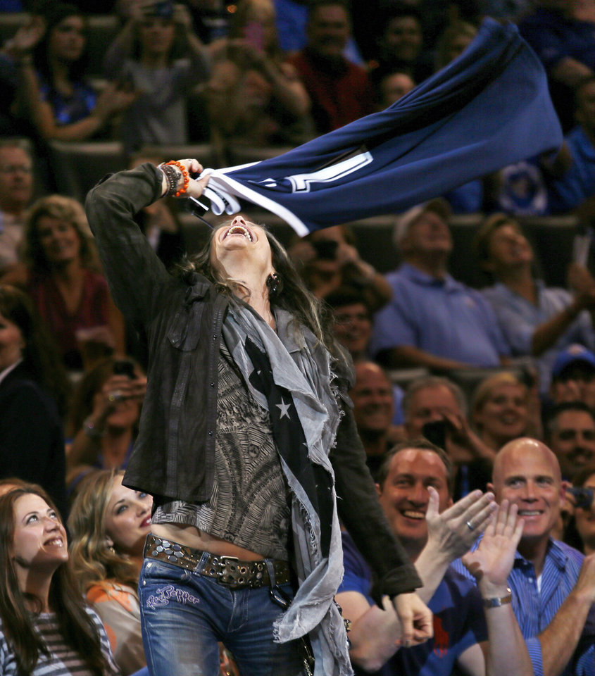 Aerosmith frontman Steven Tyler swings a customized alternate Thunder jersey given to him by Rumble the Bison during an NBA basketball game between the Detroit Pistons and the Oklahoma City Thunder at the Chesapeake Energy Arena in Oklahoma City, Friday, Nov. 9, 2012. Oklahoma City won, 105-94. Photo by Nate Billings, The Oklahoman