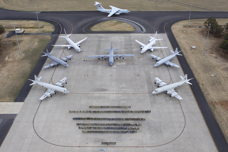 Photo - In this aerial photo taken April 29, 2014 provided by the Australia Defence Force, multinational air-crew and aircraft involved in operation
