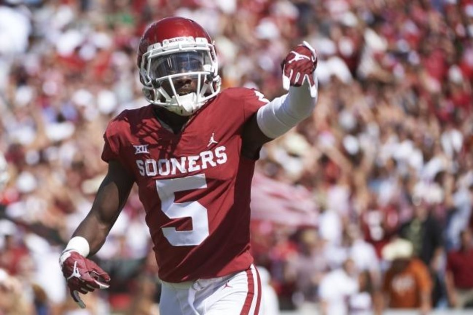 Photo -  Oklahoma receiver Marquise Brown threw up the Horns Down during last season's Red River Rivalry. Big 12 coordinator of officials Greg Burks said Tuesday making the hand gesture won't automatically be called a penalty.