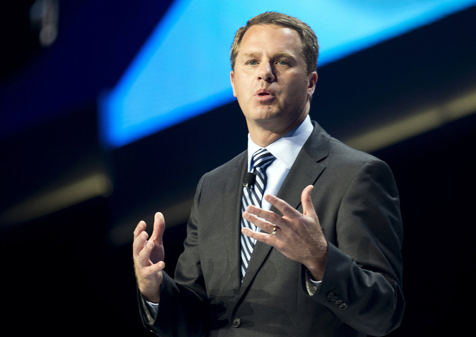 Photo - Doug McMillon, President and CEO of Wal-Mart Stores Inc., speaks during the annual Wal-Mart Shareholders meeting in Fayetteville, Ark., Friday June 6, 2014. The meeting drew about 14,000 people, including its workers from around the globe. (AP Photo/Sarah Bentham)