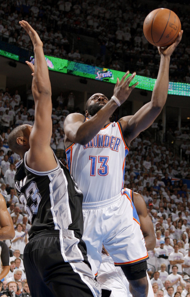 Photo - Oklahoma City's James Harden (13) goes past San Antonio's Boris Diaw (33) during Game 6 of the Western Conference Finals between the Oklahoma City Thunder and the San Antonio Spurs in the NBA playoffs at the Chesapeake Energy Arena in Oklahoma City, Wednesday, June 6, 2012. Oklahoma City won 107-99. Photo by Bryan Terry, The Oklahoman