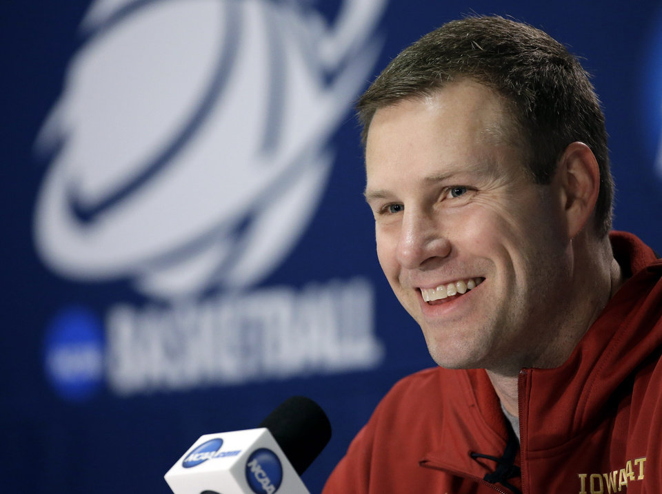 Photo - Iowa State coach Fred Hoiberg smiles as he answers a question during an NCAA college basketball tournament news conference Saturday, March 22, 2014, in San Antonio. Iowa State will play North Carolina Sunday. (AP Photo/David J. Phillip)