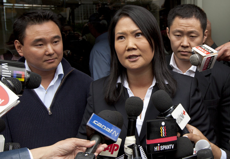The children of Peru's former and jailed President Alberto Fujimori, Keiko, center, Hiro, left, and Kenyi, right, speak to the press after turning in a document seeking their father's pardon for humanitarian reasons, citing his health, outside the Justice Ministry building in Lima, Peru, Wednesday, Oct. 10, 2012. The 74-year-old Fujimori is serving a 25-year sentence for crimes against humanity related to death-squad killings during his rule in the 1990s. (AP Photo/Martin Mejia)