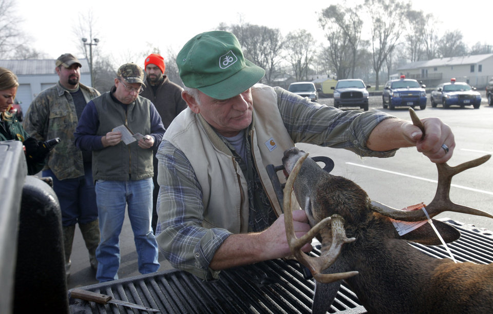 Dan Anson, retired from the DNR, volunteers to collect data of the first day of firearm deer season Thursday, Nov. 15, 2012 at the DNR check in Plainwell, Mich.(AP Photo/The Kalamazoo Gazette, Mark Bugnaski) ALL LOCAL TV OUT; LOCAL TV INTERNET OUT