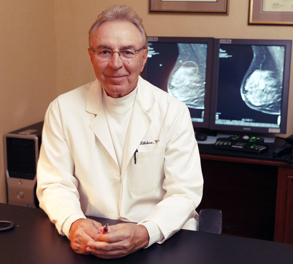 Photo - Dr. Larry Killebrew sits in his office at the Oklahoma Breast Care Center in Oklahoma City. Photo By Paul Hellstern, The Oklahoman