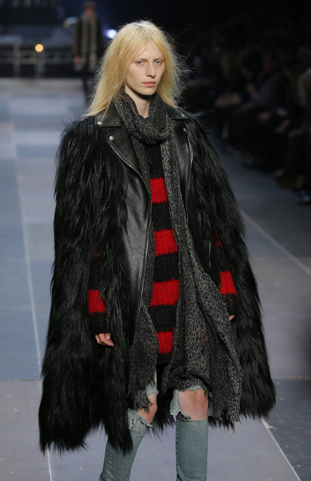 A model wears a creation by Born French fashion designer Hedi Slimane for St Laurent as part of the Men\'s fall-winter 2013-2014 fashion collection presented in Paris, Sunday , Jan. 20 2013 (AP Photo/ Jacques Brinon)