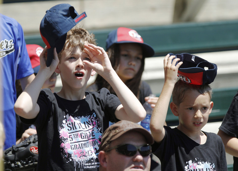 Photo - OKLAHOMA CITY REDHAWKS / MINOR LEAGUE BASEBALL / KIDS DAY / CHILD / CHILDREN: Nicholas Kiefer, left, and Weston Ernce, from Stillwater's Skyline Elementary School watch the game during Kids Day at the Chickasaw Bricktown Ballpark in Oklahoma City, OK, Tuesday, May 14, 2013,  By Paul Hellstern, The Oklahoman
