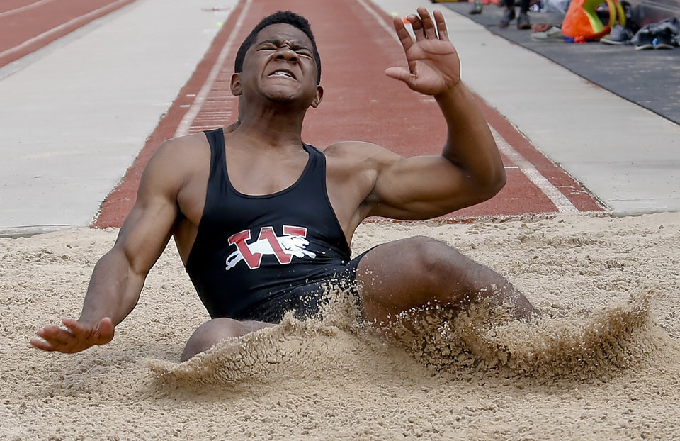Photo - Westmoore's Kieron Hardrick competes in the Class 6A boys long during the Class 6A and 5A state championship track meet at Yukon High School on Saturday, May 17, 2014 in Yukon, Okla.   Photo by Chris Landsberger, The Oklahoman