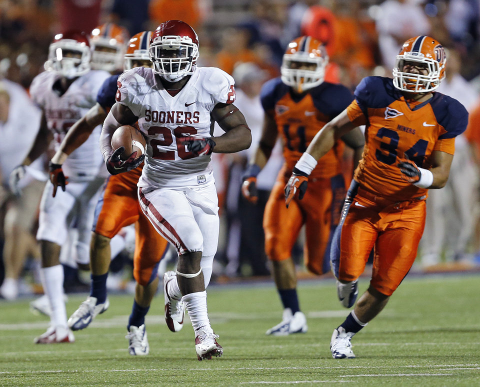 Oklahoma Sooners running back Damien Williams (26) runs for a touchdown past the UTEP defense during the college football game between the University of Oklahoma Sooners (OU) and the University of Texas El Paso Miners (UTEP) at Sun Bowl Stadium on Sunday, Sept. 2, 2012, in El Paso, Tex.  Photo by Chris Landsberger, The Oklahoman