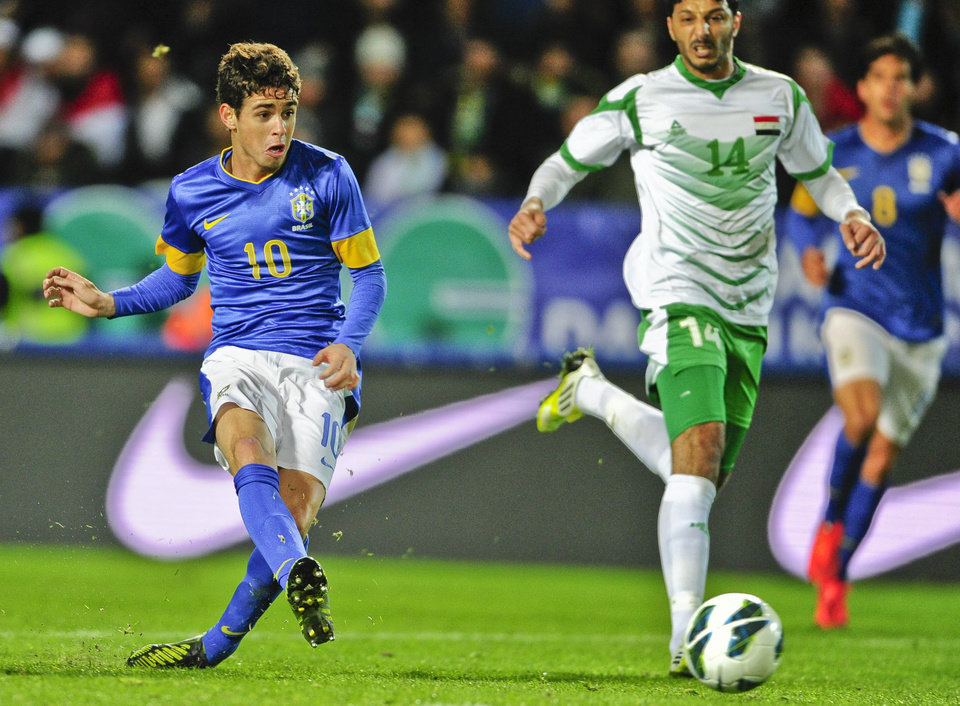 Brazil's Oscar scores 1-0 in the international friendly match in football between Brazil and Iraq at Swedbank Stadion in Malmo, Sweden, Thursday Oct. 11, 2012. Iraq's Salam Shaker to the right. (AP photo / Scanpix Sweden / Bjorn Lindgren) ** SWEDEN OUT **
