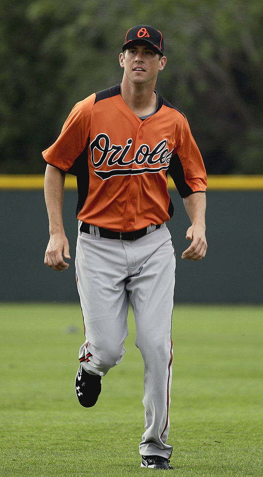 Photo -   Baltimore Orioles pitcher Brian Matusz warms up during a baseball spring training workout Thursday, Feb. 23, 2012, in Sarasota, Fla. (AP Photo/David Goldman)