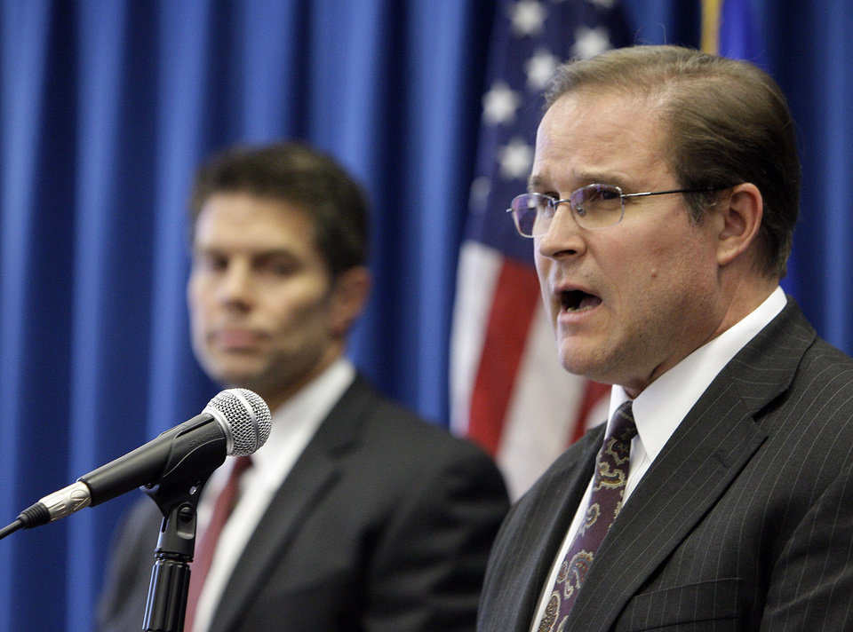 Bill Lewis, assistant agent in charge of the FBI's Los Angeles field office, right, and David Bowdich, special agent in charge of the FBI's L.A. area counterterrorism unit, discuss the arrests of four men suspected of promoting terrorist activities in counties east of Los Angeles, at a news conference at FBI headquarters in Los Angeles Tuesday, Nov. 20, 2012. (AP Photo/Reed Saxon)