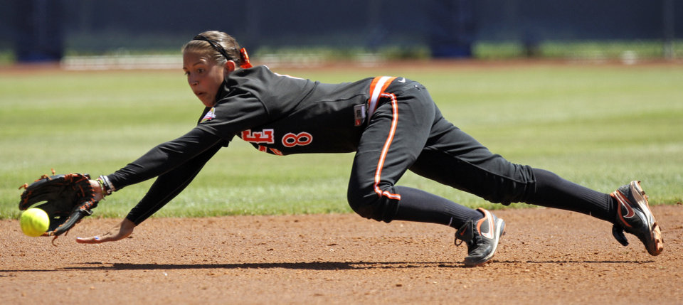 Photo - Oklahoma State's Chelsea Garcia (8) dives for the ball in the first inning of a Women's College World Series softball game between Oklahoma State University and California at ASA Hall of Fame Stadium in Oklahoma City, Saturday, June 4, 2011. California won, 6-2. Photo by Bryan Terry, The Oklahoman