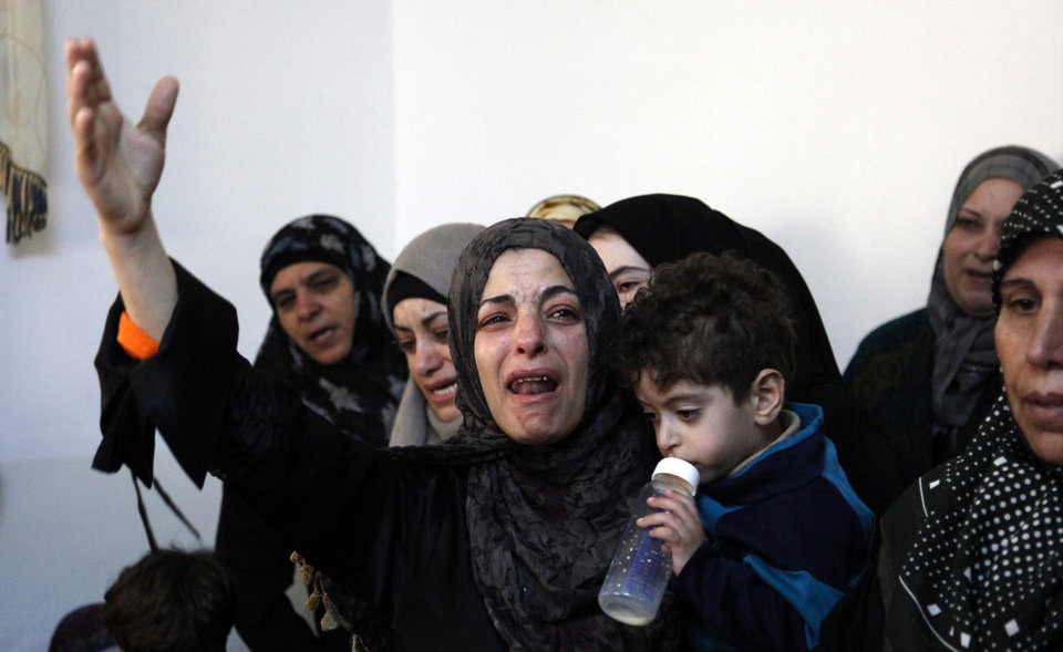Photo -   The sister of Qais al Omari, 27, and other relatives weep prior to his funeral, Friday Nov. 16, 2012, in Kofr Assad village, Jordan, north of the capital, Amman. Al- Omari, 27, was shot by Jordanian police, during a demonstration following an announcement of raising fuel prices, including a hike on cooking gas last Tuesday. (AP Photo/Mohammad Hannon)