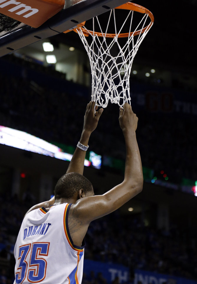 Photo - Oklahoma City's Kevin Durant (35) hangs on the basket in the fourth quarter during Game 5  in the first round of the NBA playoffs between the Oklahoma City Thunder and the Houston Rockets at Chesapeake Energy Arena in Oklahoma City, Wednesday, May 1, 2013. Photo by Sarah Phipps, The Oklahoman