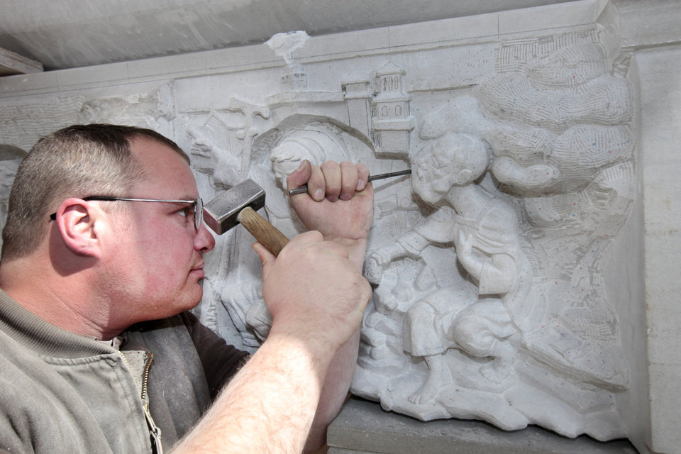 Photo - Andrew Wilson Smith carves a stone over the doorway to the church at Clear Creek Monastery, Thursday, March 14, 2013. Special Easter Sunday package about monks at Benedictine monastery at Our Lady of Clear Creek Abbey near Hulbert.  Reporters are Bryan Painter and Carla Hinton.Photo By David McDaniel/The Oklahoman