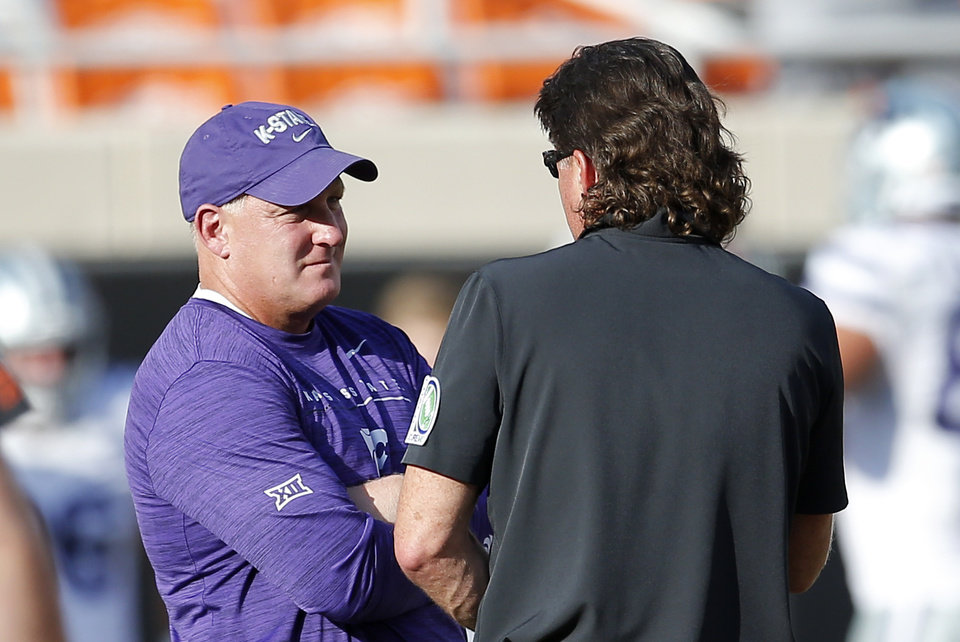 Photo - Oklahoma State head coach Mike Gundy talks with Kansas State head coach Chris Klieman before the college football game between the Oklahoma State Cowboys and the Kansas State Wildcats at Boone Pickens Stadium in Stillwater, Okla., Friday, Sept. 27, 2019. [Sarah Phipps/The Oklahoman]