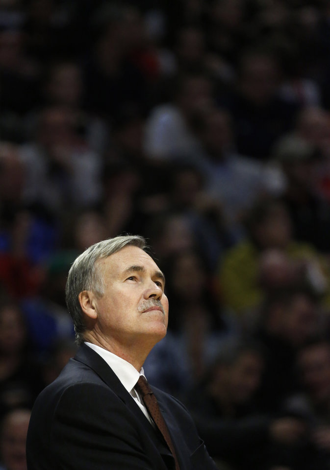 Photo - Los Angeles Lakers head coach Mike D'Antoni looks up at the scoreboard during a break in the action in the second half of an NBA basketball game against the Chicago Bulls Monday, Jan. 21, 2013, in Chicago. The Bulls won 95-83. (AP Photo/Charles Rex Arbogast)