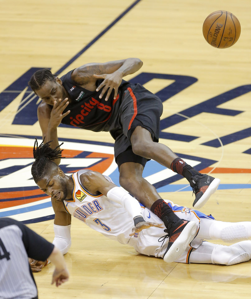 Photo - Portland's Al-Farouq Aminu (8) and Oklahoma City's Nerlens Noel (3) dive for the ball during Game 4 in the first round of the NBA playoffs between the Portland Trail Blazers and the Oklahoma City Thunder at Chesapeake Energy Arena in Oklahoma City, Sunday, April 21, 2019. Portland won 11-98.  Photo by Bryan Terry, The Oklahoman