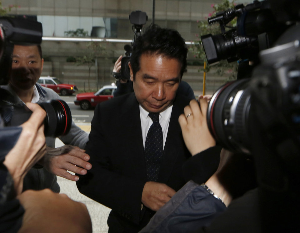 Photo - FILE - In this Feb. 28, 2014 file photo, Hong Kong businessman Carson Yeung, also owner of Birmingham City football club, arrives for the verdict in his money laundering trial at Hong Kong District Court. Yeung was found guilty Monday, March 3, 2014 of money laundering by the Hong Kong District Court. Yeung was convicted over charges relating to his handling of 721 million Hong Kong dollars ($93 million) using five bank accounts between January 2001 and December 2007. (AP Photo/Kin Cheung, File)