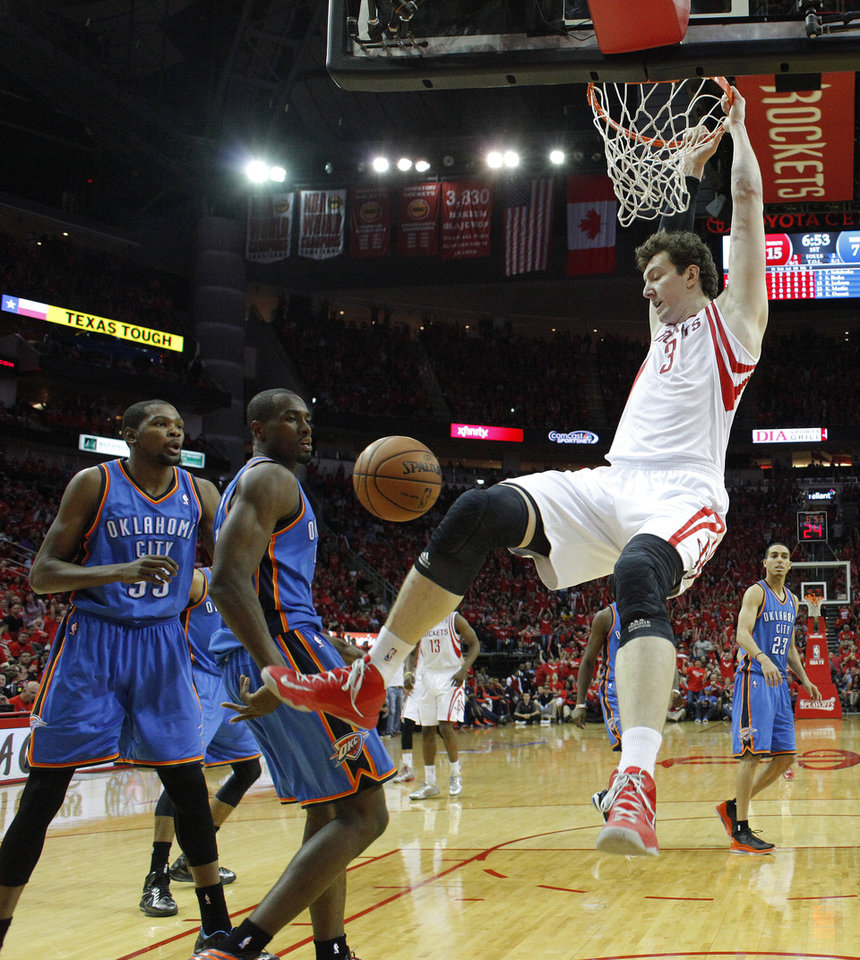 Houston\'s Omer Asik (3) dunks the ball as Oklahoma City\'s Serge Ibaka (9) and Kevin Durant (35) watch during Game 6 in the first round of the NBA playoffs between the Oklahoma City Thunder and the Houston Rockets at the Toyota Center in Houston, Texas, Friday, May 3, 2013. Photo by Bryan Terry, The Oklahoman