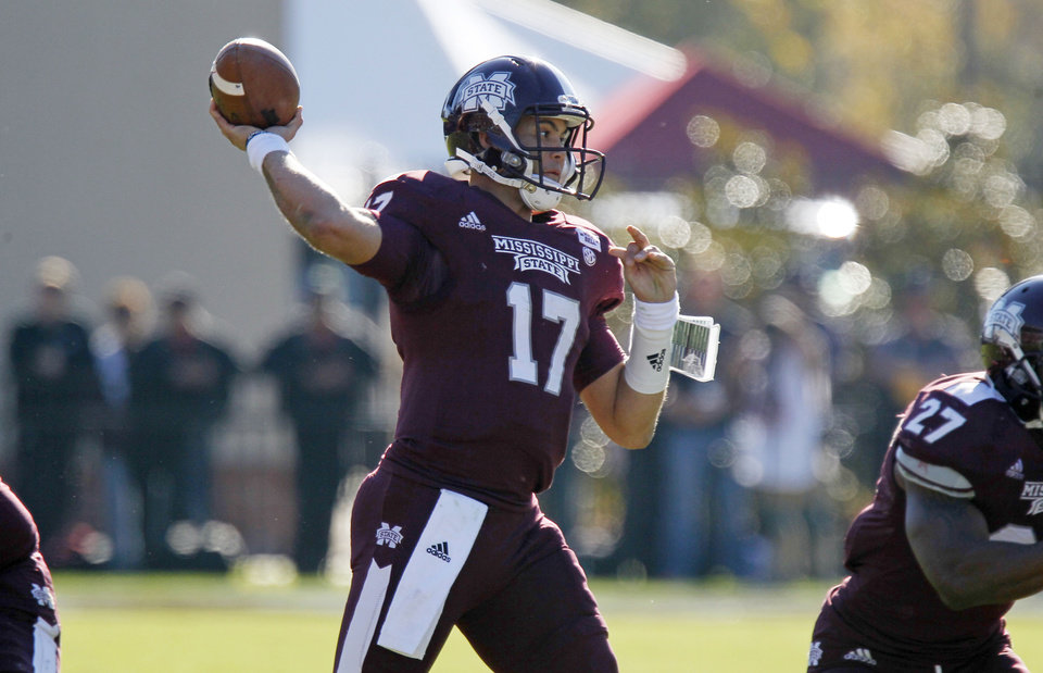 Photo -   Mississippi State quarterback Tyler Russell (17) throws a second quarter pass against Arkansas during an NCAA college football game in Starkville, Miss., Saturday, Nov. 17, 2012. Mississippi State won 45-14. (AP Photo/Rogelio V. Solis)