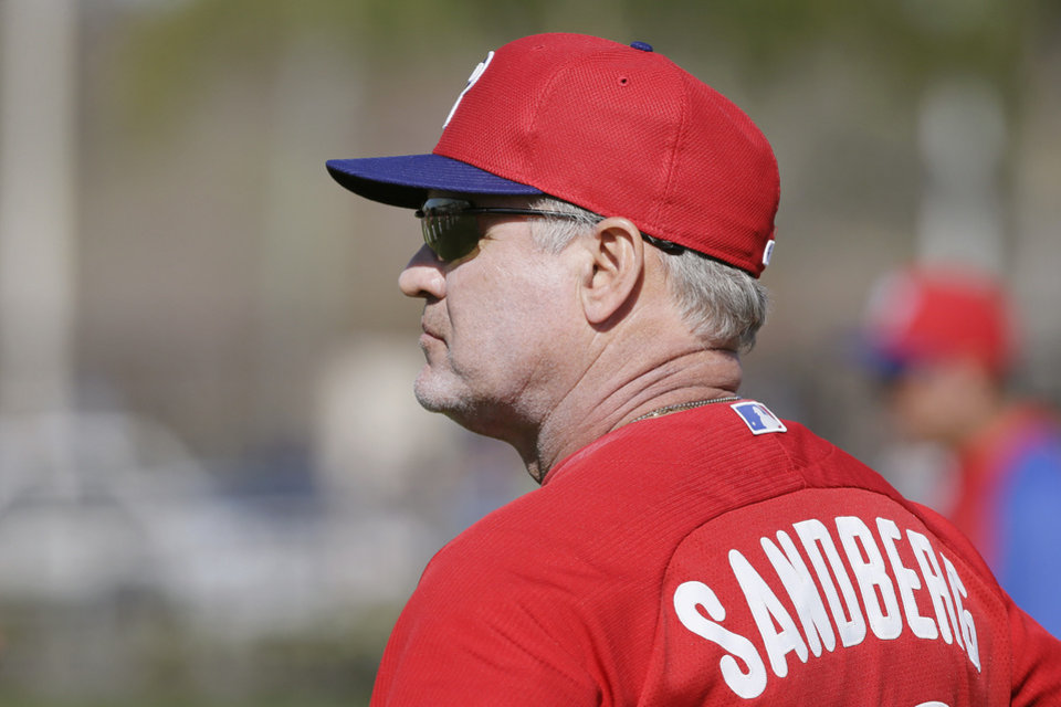 Photo - Philadelphia Phillies manager Ryne Sandberg watches his team during spring training baseball practice Wednesday, Feb. 19, 2014, in Clearwater, Fla. (AP Photo/Charlie Neibergall)