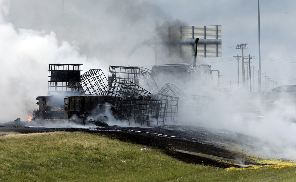 A massive fire on a northbound semi trailer loaded with roadway paint shut down Interstate 35 both north and southbound at around 6:45 p.m. on Wednesday, July 10, 2013 in Norman, Okla.  Photo by Steve Sisney, The Oklahoman <strong>STEVE SISNEY - THE OKLAHOMAN</strong>